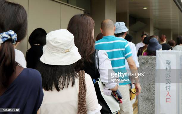 People line up for tickets outside the Saitama District Court near Tokyo on Aug 29 to hear the ruling on a 25yearold man who was accused of abducting...