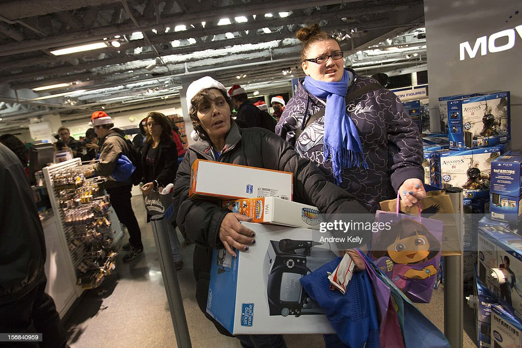 People line up for to purchase items at the Black Thursday sale at the Toys 'R' Us store in Times Square November 22, 2012 in New York City.The store got a head start on the traditional Black Friday sales by opening their doors at 8pm on Thanksgiving night.