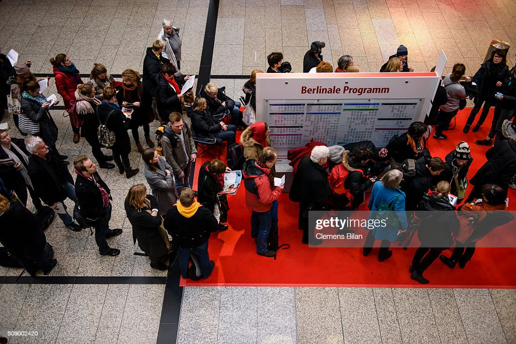 People line up in front of a ticket counter prior to the 66th Berlinale on February 8, 2016 in Berlin, Germany.