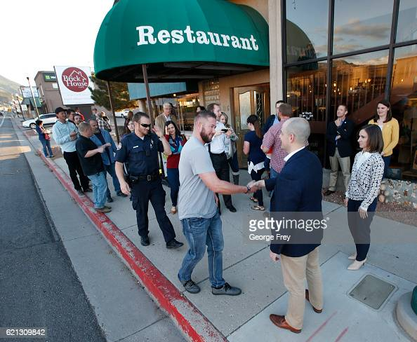 People line up in front of the Brick House Cafe for pictures with US independent presidential candidate Evan McMullin and his running mate Mindy Finn...
