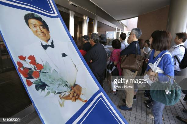People line up in front of the memorial museum of popular actor and singer Yujiro Ishihara in the northern Japan city of Otaru on Aug 31 its last day...