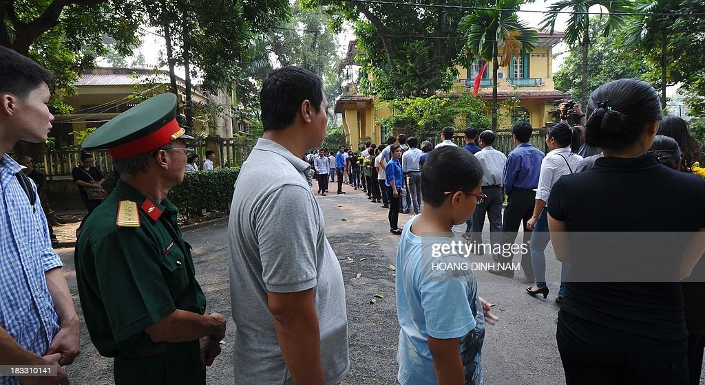 People line up in the compound of late General Vo Nguyen Giap's residence to pay homage to him, as thousands of people flocked to pay last tribute to the national independence hero in Hanoi on October 6, 2013. Vietnam announced plans to hold a national funeral for independence hero General Vo Nguyen Giap in the first official statement on the death of the ruthless but brilliant military strategist .