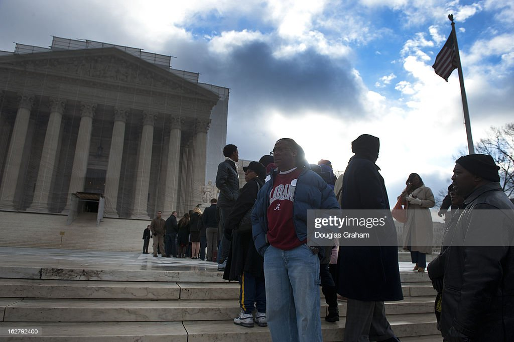 People line up in the early morning hours to hear the Shelby County, Alabama v. Holder oral arguments at the Supreme Court on the importance of protecting the right to vote for all Americans on February 27, 2013.
