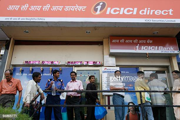 People line up outside an ICICI Bank Ltd automated teller machine in Mumbai India on Monday Oct 27 2008 ICICI Bank Ltd the Indian lender with the...