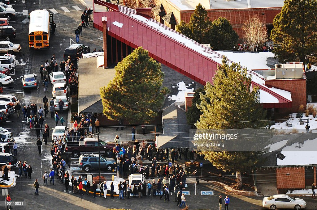 People line up outside Shepherd of the Hills Lutheran Church, one of the reunification centers, with their families following a shooting incident at Arapahoe High School. A student carried a shotgun into Arapahoe High School and shot two fellow students in Centennial, Colorado December 13, 2013.
