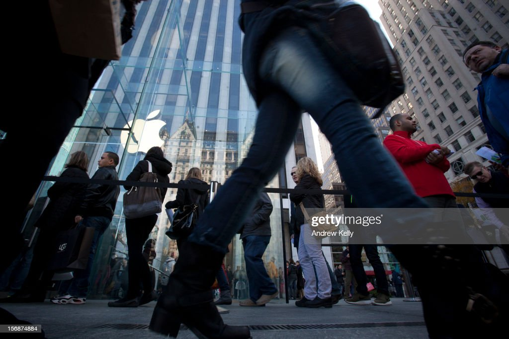 People line up outside the Apple Store on Fifth Avenue during the Black Friday sales on November 23, 2012 in New York City. Shoppers filled stores in search of the many potential bargains on offer during the traditional yearly sale, which got its name as it's said to put retailers 'in the black,' or making a profit.