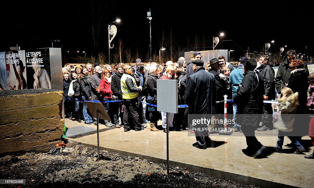 People line up outside the Louvre Museum on the first day of its opening to the public, on December 4, 2012 in Lens, northern France. The Louvre museum opened a new satellite branch among the slag heaps of a former mining town Tuesday in a bid to bring high culture and visitors to one of France's poorest areas. Greeted by a group of former miners in overalls and hardhats, President Francois Hollande inaugurated today the Japanese-designed glass and polished-aluminium branch of the Louvre in the northern city of Lens. The 150 million euro ($196 million) project was 60 percent financed by regional authorities in the Nord-Pas-De-Calais region, on the English Channel and the border with Belgium.