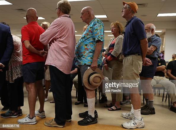 People line up to ask questions to Rep Brian Mast during a town hall meeting at the Havert L Fenn Center on February 24 2017 in Fort Pierce Florida...