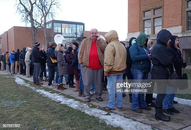 People line up to attend a Donald Trump campaign rally raising funds for US military veterans at Drake University in Des Moines Iowa on January 28...