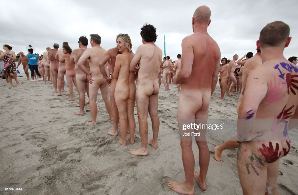 People line up to be counted prior to running into the water during an attempt to break the skinny dip world record at Papamoa Beach on December 2, 2012 in Tauranga, New Zealand.