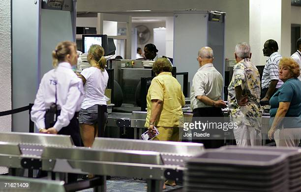 People line up to be screened at the metal detectors and Xray machines at the Miami International Airport August 10 2006 in Miami Florida The...