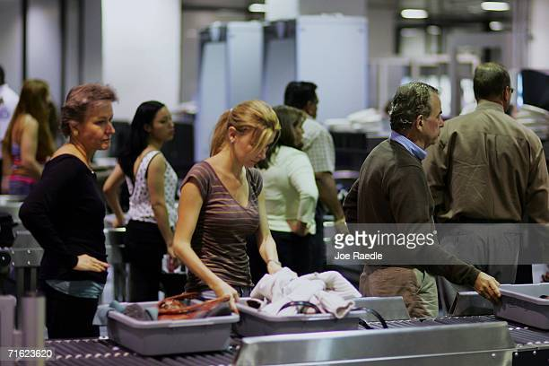 People line up to be screened at the metal detectors and Xray machines at the Miami International Airport August 10 2006 in Miami Florida US airports...