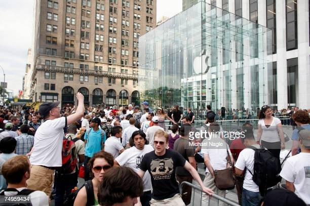 People line up to be the first to buy an iPhone at Apple's flagship store on Fifth Avenue on June 29 2007 in New York City Hype for the iPhone which...