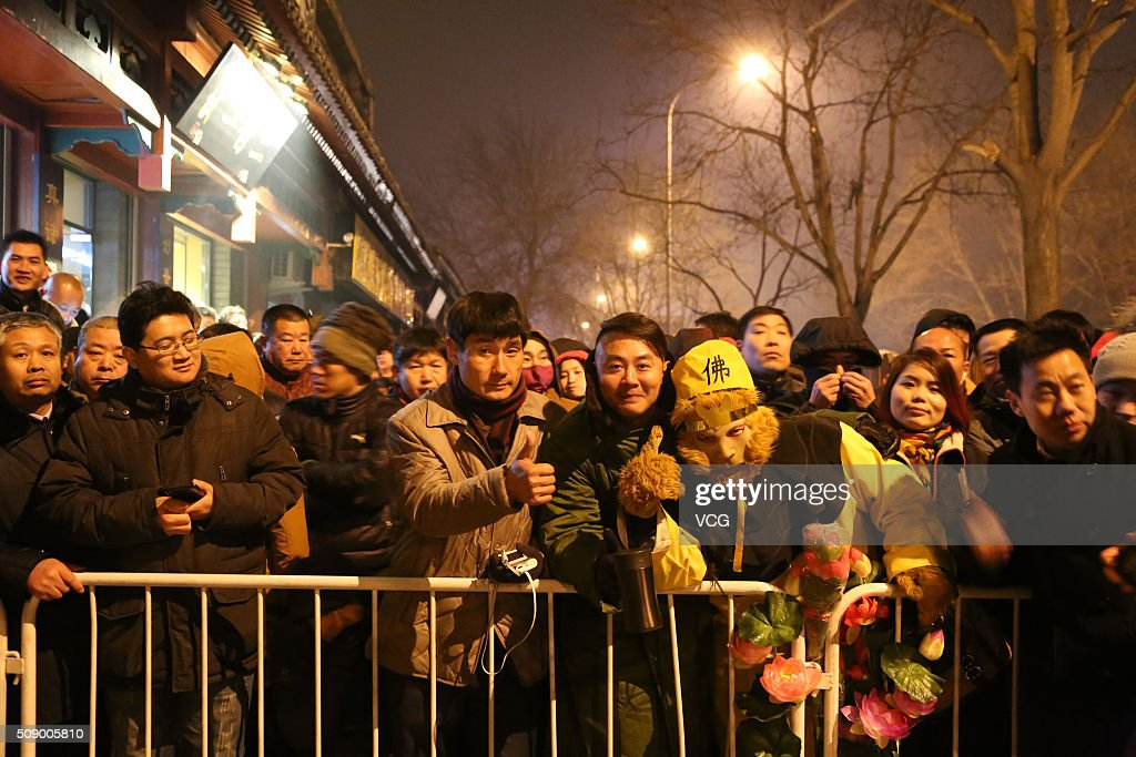 People line up to burn incense to pray for good luck and fortune at the Lama Temple (or Yonghe Temple) early morning on first day of new Year of Monkey on February 8, 2016 in Beijing, China. Chinese people celebrate the Spring Festival for the new Year of Monkey, which fell on February 8 according to Chinese calendar.