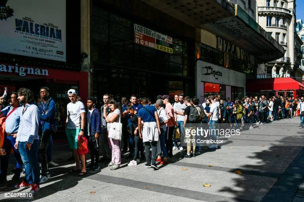 People line up to buy Brazilian star Neymar's PSG new jersey outside the ParisSaintGermain football club store on the Champs Elysees avenue in Paris...