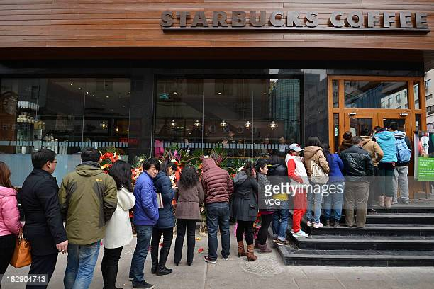 People line up to buy coffee during a Starbucks Coffee shop opening ceremony on March 1 2013 in Taiyuan China Taiyuan's first Starbucks officially...