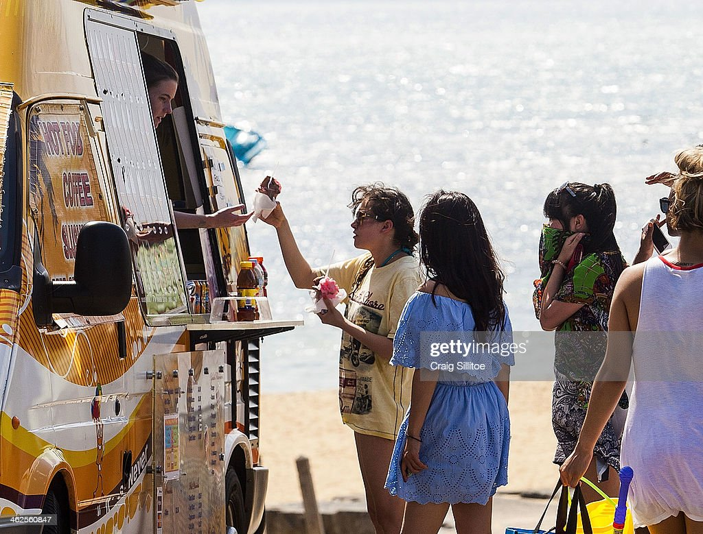 People line up to buy ice creams at Brighton Beach on January 14, 2014 in Melbourne, Australia. Temperatures are expected to reach over 40 degrees Celsius in parts of Victoria over the next four days.