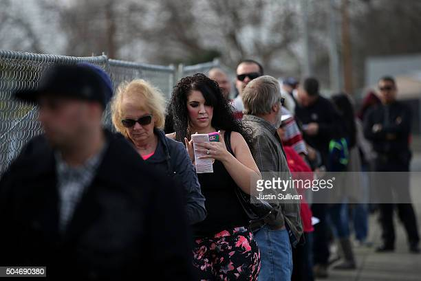 People line up to buy Powerball tickets at Kavanagh Liquors on January 12 2015 in San Lorenzo California Dozens of people lined up outside of...