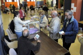 People line up to cast their ballot at a polling station during the second round of a local byelection on October 13 2013 in Brignoles southern...