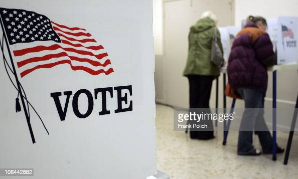 People line up to cast their ballot at the Highwood Recreation Center November 2 2010 in Highwood Illinois US Congressman Mark Kirk is locked in a...