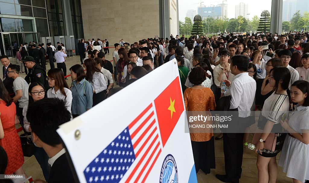 People line up to enter the National Convention Center where US President Barack Obama will deliver a live-broacast speech in Hanoi on May 24, 2016. US President Barack Obama told communist Vietnam on May 24 that basic human rights would not jeopardise its stability, in an impassioned appeal for the one-party state to abandon authoritarianism. / AFP / POOL / HOANG