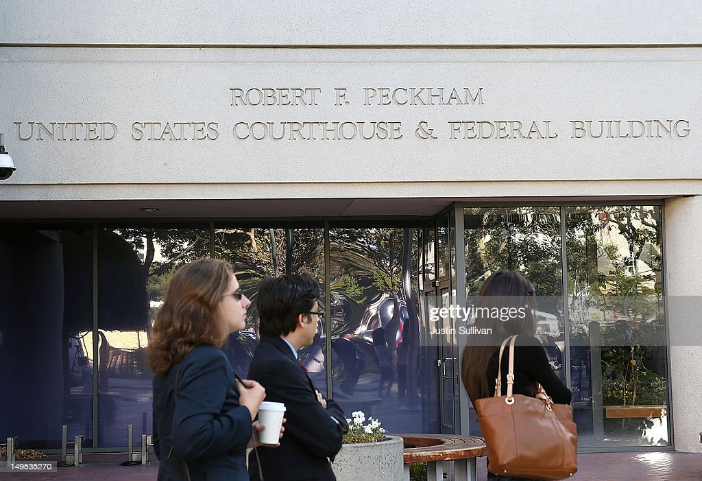 People line up to enter the Robert F. Peckham Federal Courthouse on July 30, 2012 in San Jose, California. The trial in the Apple Inc. and Samsung Electronics Co. patent battle begins today at a San Jose federal courthouse to determine if Samsung illegally copied technolgy used in Apple's popular iPhone and iPads. Apple is seeking $2.5 billion in damages.