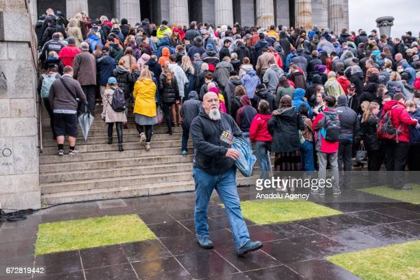 People line up to enter the Shrine to pay their respects during the dawn service of the ANZAC day commemoration at the Shrine of Remembrance in...