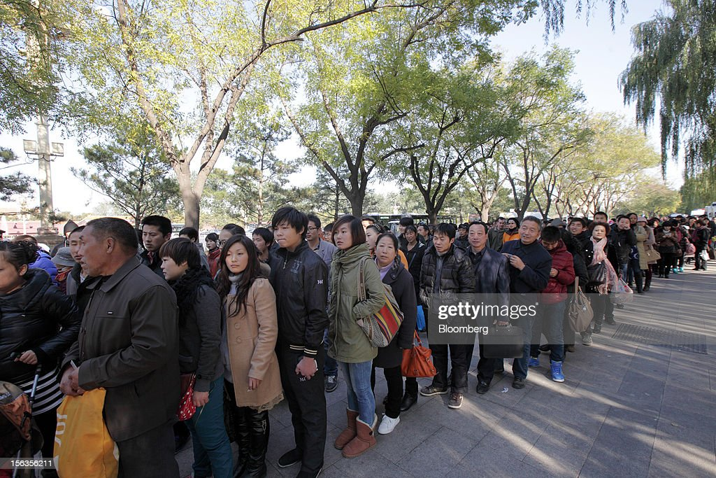 People line up to enter Tiananmen Gate following the closing session of the 18th National Congress of the Communist Party of China in Beijing, China, on Wednesday, Nov. 14, 2012. Vice President Xi Jinping and Vice Premier Li Keqiang were reappointed to the Chinese Communist Party's Central Committee, positioning them to take over the top two posts in the world's second-biggest economy. Photographer: Tomohiro Ohsumi/Bloomberg via Getty Images