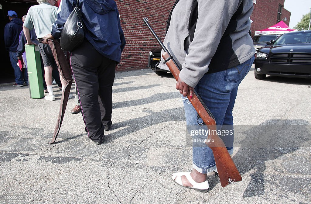 People line up to exchange their guns for a $50 Meijer gift card at a 'Groceries For Guns' gun buyback program May 18, 2013 at the New St. Paul Tabernacle Church of God in Christ in Detroit, Michigan. The event was sponsored by the law firm Goodman Acker P.C. in a public-private partnership with Wayne County.