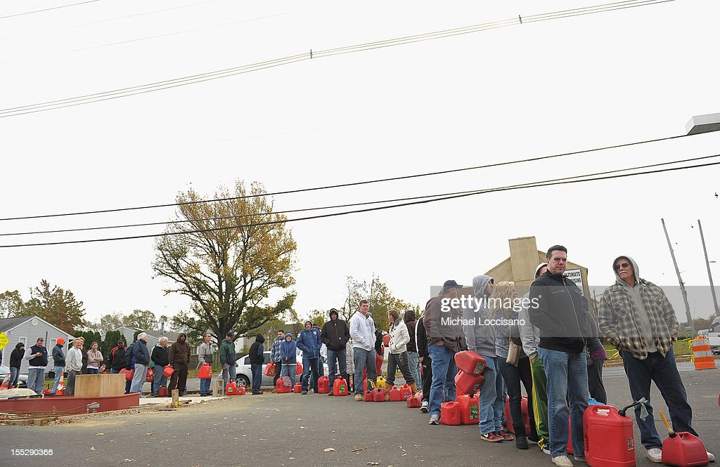 People line up to fill gas canisters at a Shell gas station on November 2, 2012 in Matawan, New Jersey. According to AAA, 60 % of gas stations in New Jersey are or were closed due to Superstorm Sandy.