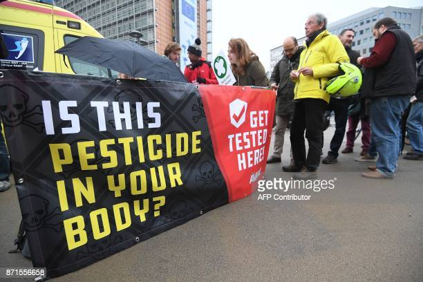 People line up to get a free glyphosate testing organized by global citizens movement Avaaz in front of the European Commission in Brussels on...
