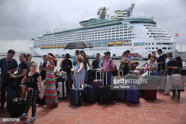 People line up to get on a Royal Caribbean International Adventure of the Seas relief boat that is sailing to Ft Lauderdale Florida with evacuees...