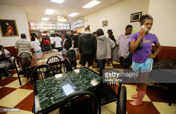 People line up to order food in a Chinese restaurant on Canal Street that quickly reopened following the passing of the heaviest rains of Hurricane...