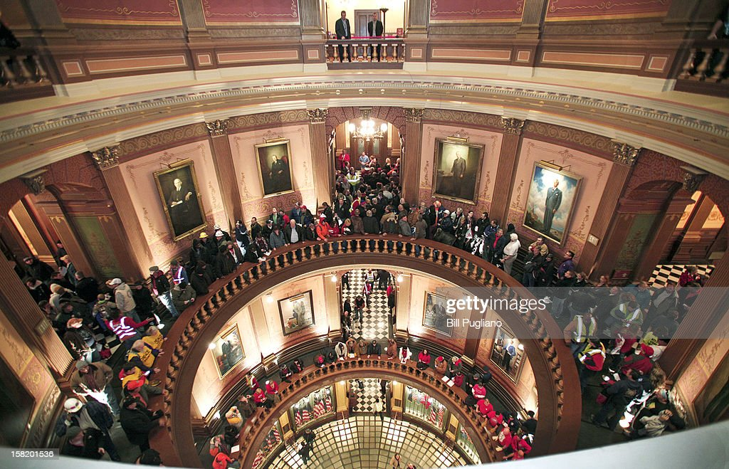 People line up to try to enter the House Chamber where a vote is scheduled to take place on Right-to-Work legislation at the Michigan State Capitol December 11, 2012 in Lansing, Michigan. Republicans control the Michigan House of Representatives, and Michigan Gov. Rick Snyder has said he will sign the bill if it is passed. The new law would make requiring financial support of a union as a condition of employment illegal.