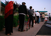 People line up to vote at the Albright United Methodist Church November 4 2008 in Phoenix Arizona Voting is underway in the US presidential elections...