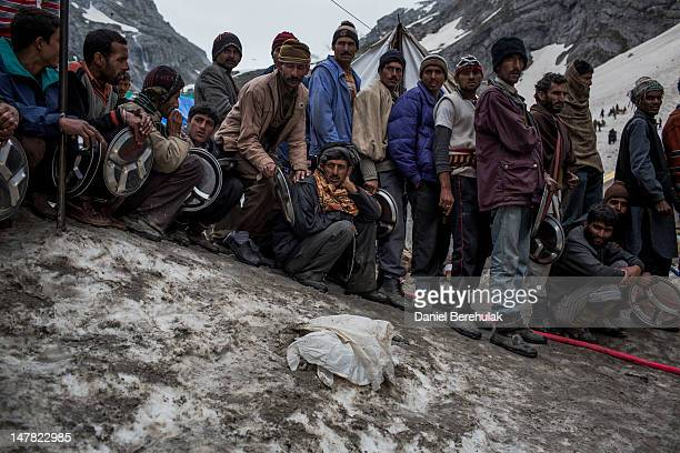 People lineup for a meal at a Lungar facility providing free food to pilgrims at a campsite close to the sacred Amarnath Cave one of the most revered...