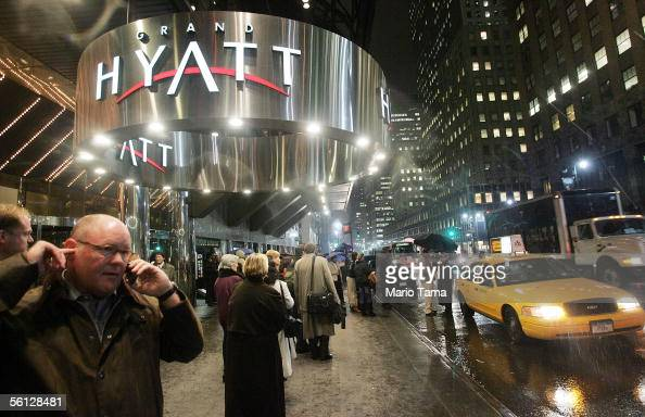 People linger outside the Grand Hyatt hotel November 9 2005 in New York City At least 57 people were killed in a series of terror attacks against...