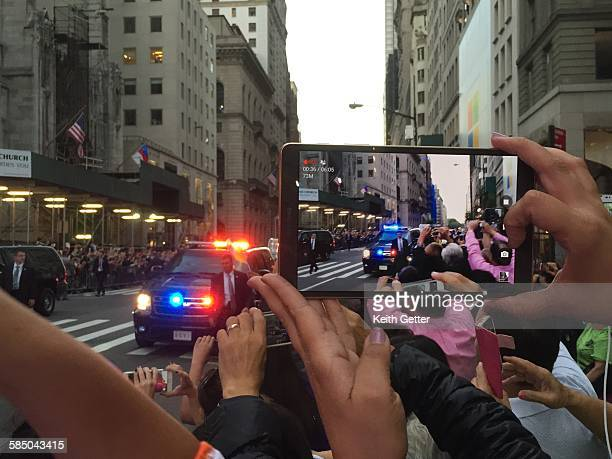 People lining Manhattan's Fifth Avenue in NYC taking pictures with mobile devices as Pope Francis' historic papal visit to the City of New York...