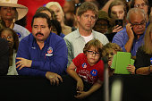 People listen as Democratic presidential candidate Hillary Clinton speaks during her campaign stop at the Broward College Ð Hugh Adams Central Campus...