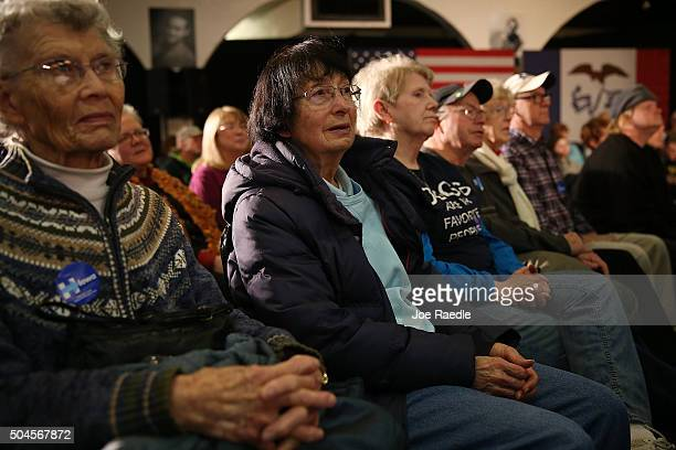 People listen as Democratic presidential candidate Hillary Clinton speaks during a campaign stop at the Electric Park Ballroom on January 11 2016 in...
