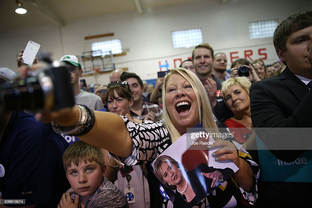 People listen as Democratic presidential candidate <a gi-track='captionPersonalityLinkClicked' href=/galleries/search?phrase=Hillary+Clinton&family=editorial&specificpeople=76480 ng-click='$event.stopPropagation()'>Hillary Clinton</a> speaks during a campaign stop at the Douglass Park Gymnasium on May 1, 2016 in Indianapolis, Indiana. Presidential candidates continue to campaign across the state leading up to Indiana's primary day on Tuesday.