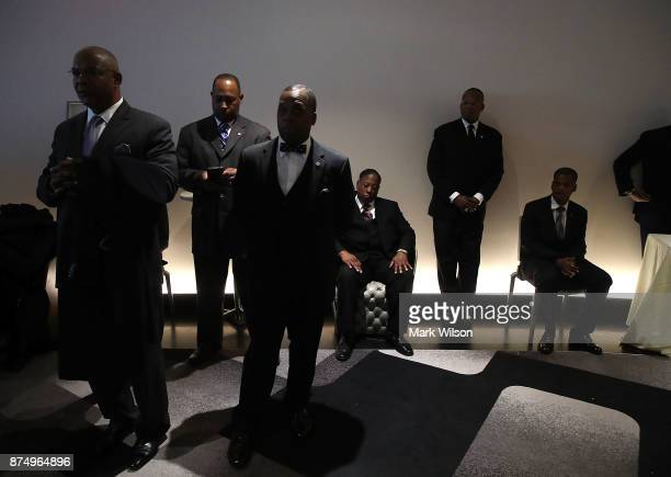 People listen as Nation of Islam Minister Louis Farrakhan delivers a speech and talks about US President Donald Trump at the Watergate Hotel on...