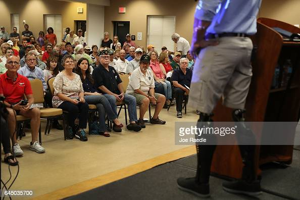 People listen as Rep Brian Mast speaks during a town hall meeting at the Havert L Fenn Center on February 24 2017 in Fort Pierce Florida Rep Mast...