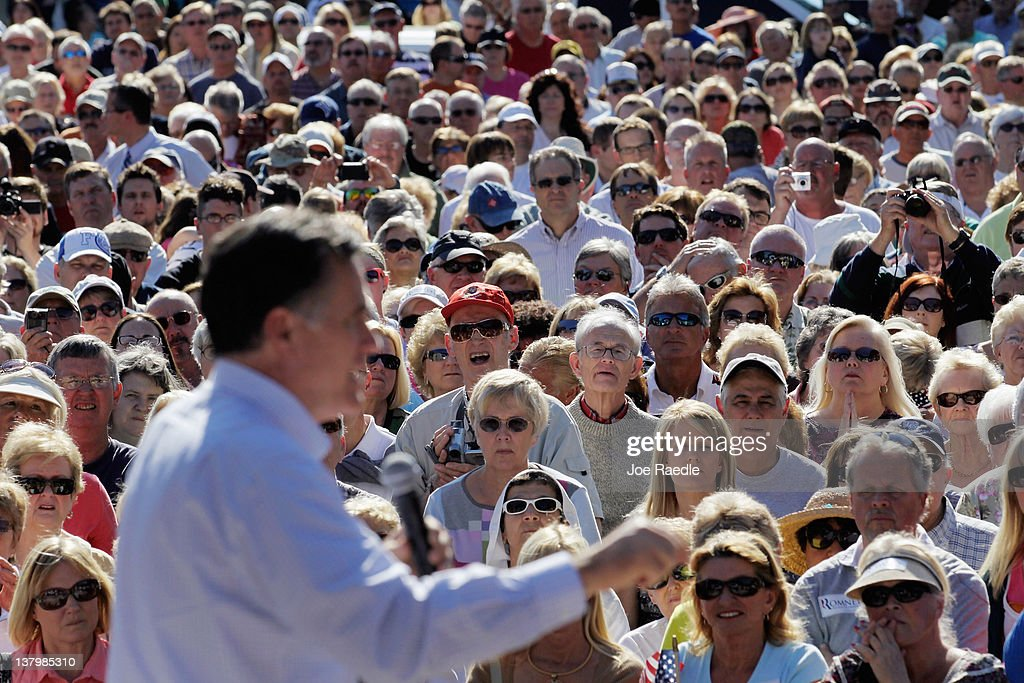 People listen as Republican presidential candidate and former Massachusetts Gov. Mitt Romney speaks during a rally with supporters at Pioneer Park on January 30, 2012 in Dunedin, Florida. Romney is campaigning across the state ahead of the January 31 Florida primary.