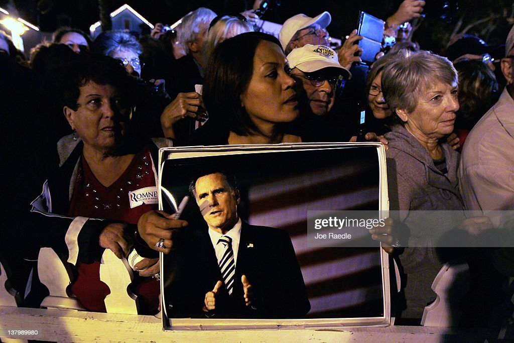People listen as Republican presidential candidate, former Massachusetts Gov. Mitt Romney delivers a speech during a grassroots rally with supporters at Lake Sumter Landing on January 30, 2012 in The Villages, Florida. Romney is campaigning across the state ahead of the January 31 Florida primary.