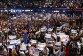 People listen as Republican presidential candidate former Massachusetts Gov Mitt Romney delivers his nomination acceptance speech during the final...