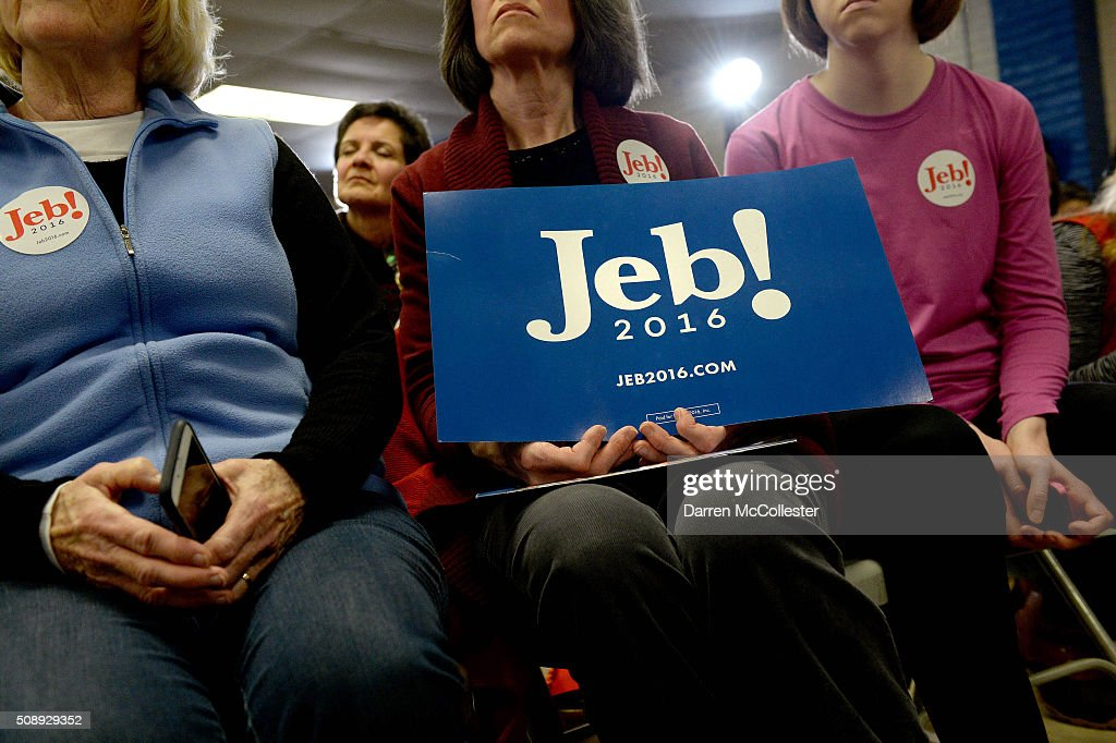 People listen as Republican Presidential candidate <a gi-track='captionPersonalityLinkClicked' href=/galleries/search?phrase=Jeb+Bush&family=editorial&specificpeople=171487 ng-click='$event.stopPropagation()'>Jeb Bush</a> holds a town hall at Woodbury School February 7, 2016 in Salem, New Hampshire. Candidates are in a last push for votes ahead of the first in the nation primary on February 9.
