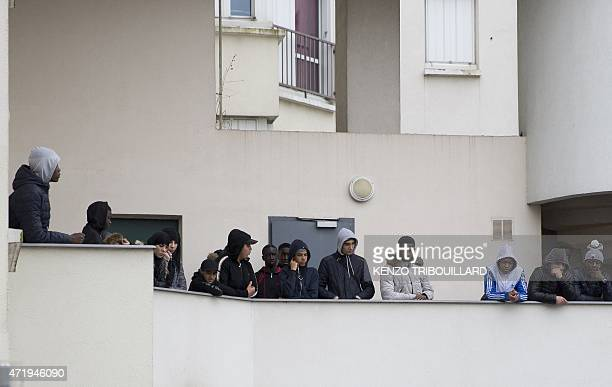People listen as Trappes Mayor addresses journalists on May 2 following the death of a 14yearold boy in Trappes west of Paris Relatives of 14yearold...