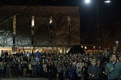 People listen during a vigil at the University of North Carolina following the murders of three Muslim students on February 11 2015 in Chapel Hill...