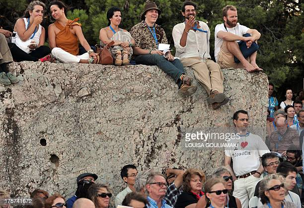 People listen to a speech by a philosopher during the XXIII World Philosophy Congress Pnyx special plenary session at the Pnyx hill opposite the...